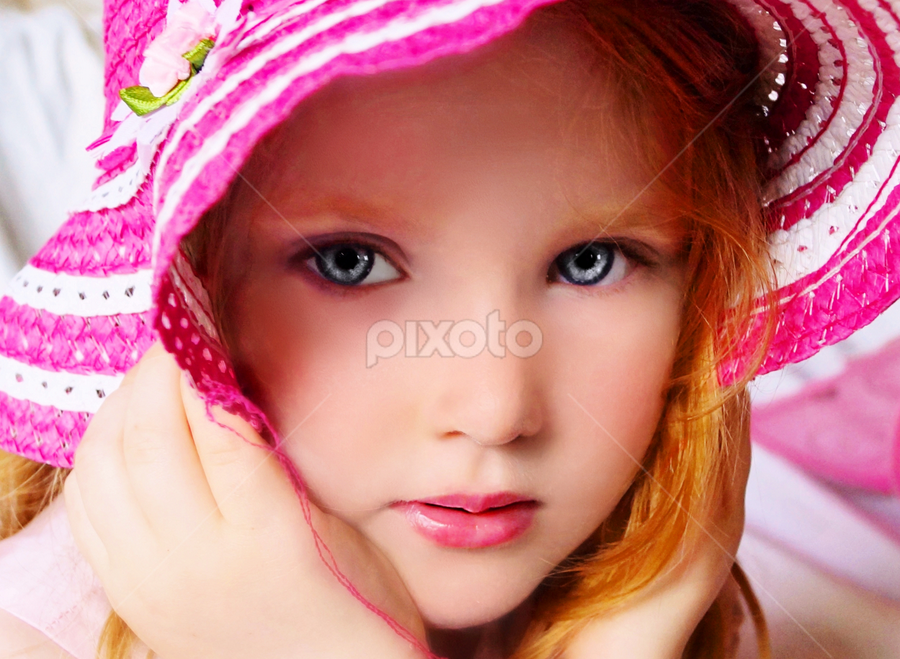 Peeking Out Of My Hat by Cheryl Korotky - Babies & Children Child Portraits ( red hair, a heartbeat in time photography, amazing faces, beautiful children, blue eyes, child model nevaeh, kids in hats, portrait,  )