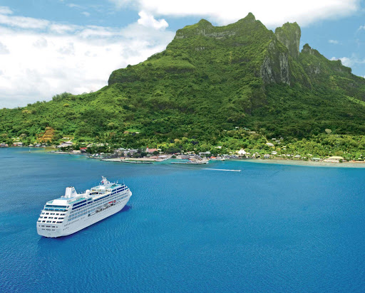 Ocean-Princess-in-BoraBora - Ocean Princess — the smallest ship in the Princess fleet along with her twin, Pacific Princess — moors off the beautiful tropical paradise of Bora Bora.