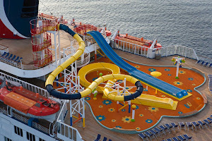 Thrillseekers of all ages can go deckside to ride the Twister waterslide and twin racing slides at WaterWorks, Carnival Sensation's aqua park.