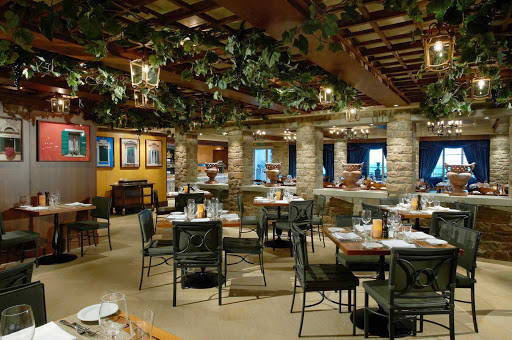 Norwegian-Breakaway-LaCucina - La Cucina, one of the fine restaurants on Norwegian Breakaway, borrows from the Tuscan countryside with a cozy ambience and rustic Italian cuisine.