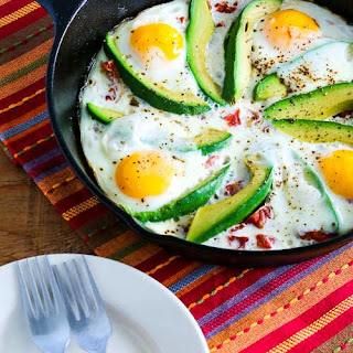 Baked Eggs Skillet with Avocado and Spicy Tomatoes.