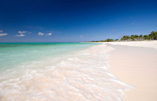 beach-island-Cozumel - Cozumel, an island off the coast of Mexico, beckons with turquoise waters and wide sandy beaches.