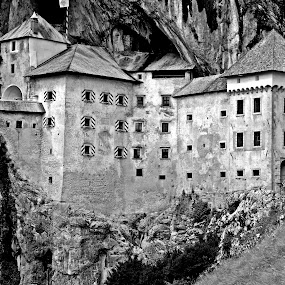 Predjama Castle by Matevz Skerget - Black & White Buildings & Architecture ( grad, black and white, predjamski, rock, castle, b&2 )