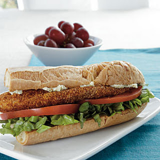 Cornmeal-Crusted Tilapia Sandwiches with Lime Butter.