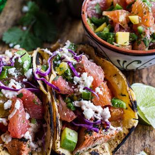 Cuban Fish Tacos with Citrus Mango Slaw + Chipotle Lime Crema.