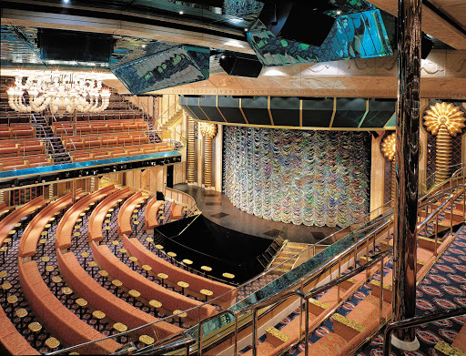 Carnival-Victory-Caribbean-Main-Lounge - The 1,400-seat Caribbean Lounge, Carnival Victory's main show theater, has a revolving stage, laser lights, retractable orchestra pit and other state-of-the-art features.