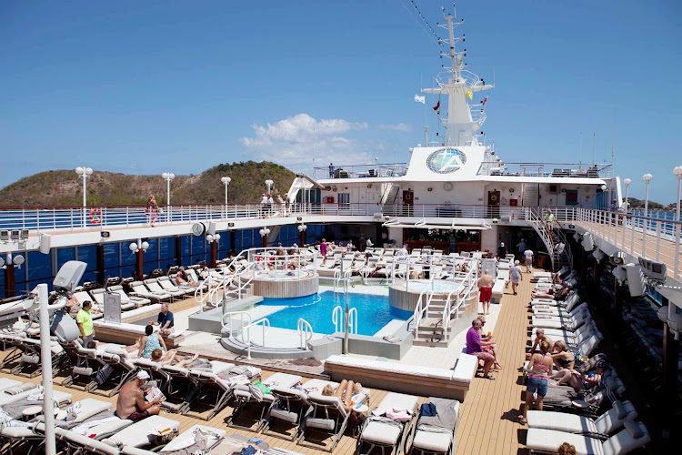 Take in the sun and the breeze on the pool deck of your Azamara cruise.