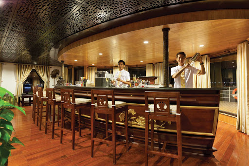 Experience first-rate service in a convivial atmosphere in the lounge of AmaLotus during your river cruise.