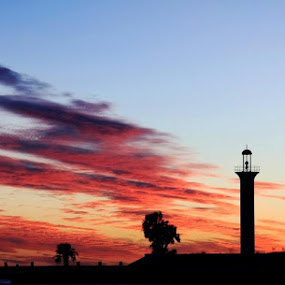 Broadwater Lighthouse by Angela Wescovich - Landscapes Sunsets & Sunrises ( clouds, biloxi, sunset, lighthouse, landscape,  )
