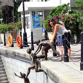 Just a little push by Leong Jeam Wong - City,  Street & Park  Street Scenes ( riverside, play, children, push, river, jump )