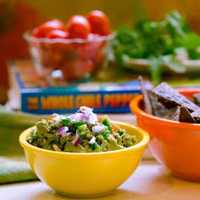 Guacamole and chips by Lisa Mirante - Food & Drink Plated Food ( bowl, chips, cook, cilantro, tomato, cookbook, food, corn chips, avocado, guacamole, cooking, salsa )