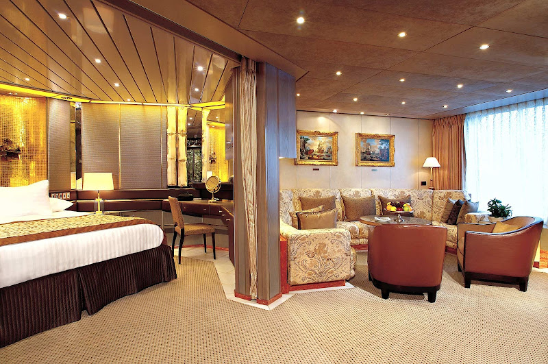 Book a Pinnacle Suite, also known as a Penthouse Suite, aboard your Holland America cruise and spread out with 1,296 square feel, including a king bed, and oversize whirlpool bath & shower.