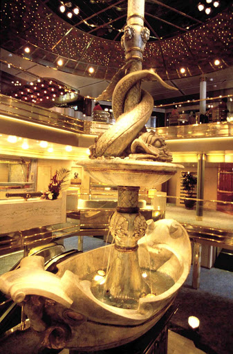 Holland-America-Ryndam-Atrium - At the heart of Ryndam of Holland America Line is a three-story atrium that features a monumental fountain created by sculptor Gilbert Lebigre in Pietrasanta, Italy.