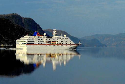 cruise-ship-on-Saguenay-River-Quebec - The 423-passenger cruise ship C. Columbus sails the Saguenay River in Cote-Nord Ð Manicouaga, Quebec.