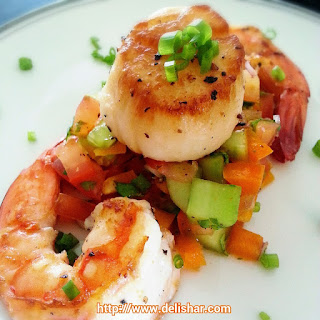 Seared Scallops & Prawns on Cucumber Salsa.