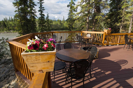 deck-McKinley-chalet-Denali - The McKinley Chalet Resort is in the heart of the Denali Canyon on the banks of the Nenana River, less than 2 miles from the entrance to Denali National Park. In summer, dining on the deck gives you a great view of the scenic vistas.