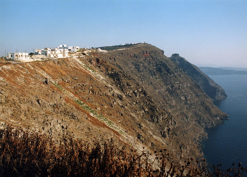 The caldera of Santorini with a view of the whitewashed houses of Fira perched atop sheer cliffs that plunge a thousand feet to the sea. An ocean-filled volcanic ring was left behind by a titanic eruption 3,500 years ago that devastated the region. It's one of the most stunning views in the world.
