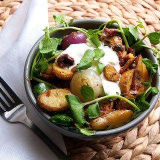 Roasted Fingerling Potatoes & Cipollini Onions with Cress, Sundried Tomatoes, Oregano, & Blue Cheese Crema