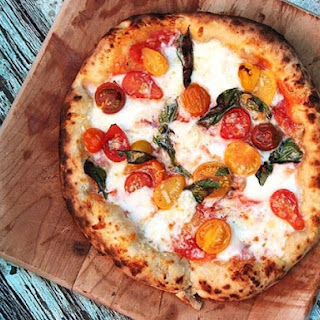 Pizza With Cherry Tomatoes, Garlic, Basil, and Mozzarella