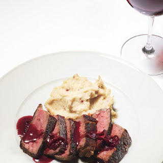 Pan-Seared Strip Steak with Red-Wine Pan Sauce and Pink-Peppercorn Butter.