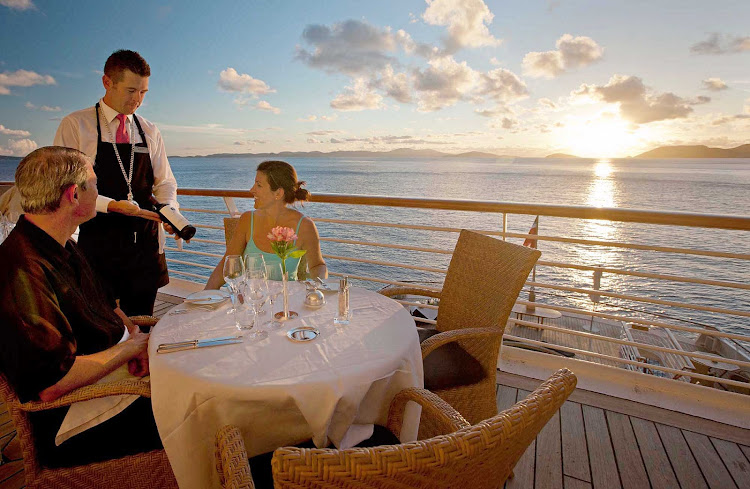 Dine al fresco and watch the sun set over shimmering waters during your SeaDream sailing.