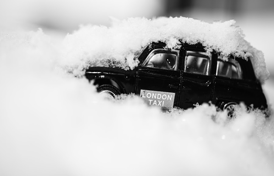 Did anyone call for a taxi? by Andreea Alexe - Artistic Objects Still Life ( car, taxi, toy, london, in snow, black and white, close-up, covered,  )