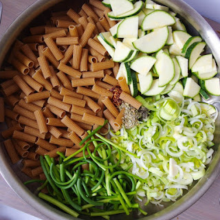 One Pot Pasta with Zucchini, Garlic Scapes, and Leeks in a White Wine Lemon Sauce.