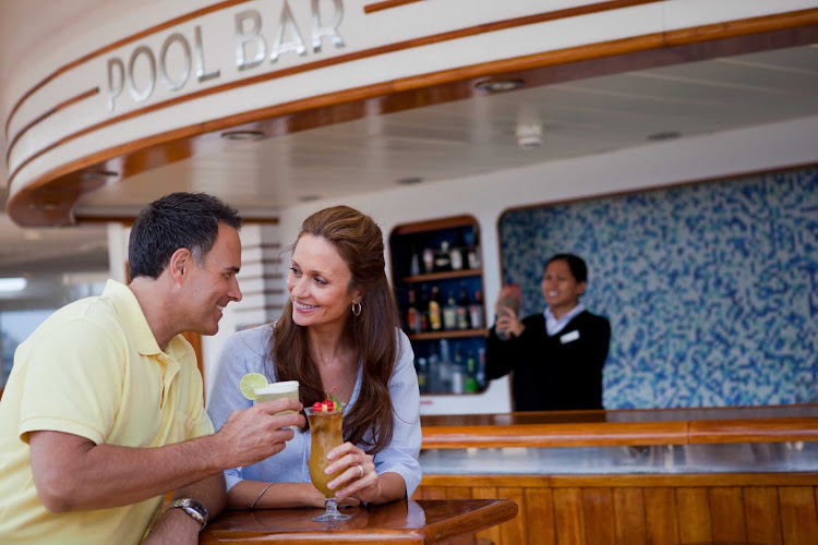 Order lunch at the casual al fresco Pool Bar and Grill at no extra charge as part of your all-inclusive cruise aboard Seven Seas Mariner.