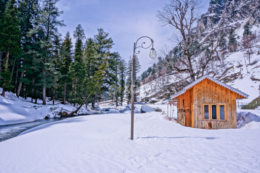 Beautiful Hut On Snowy Mountains Riverside By Bharat Bhushan