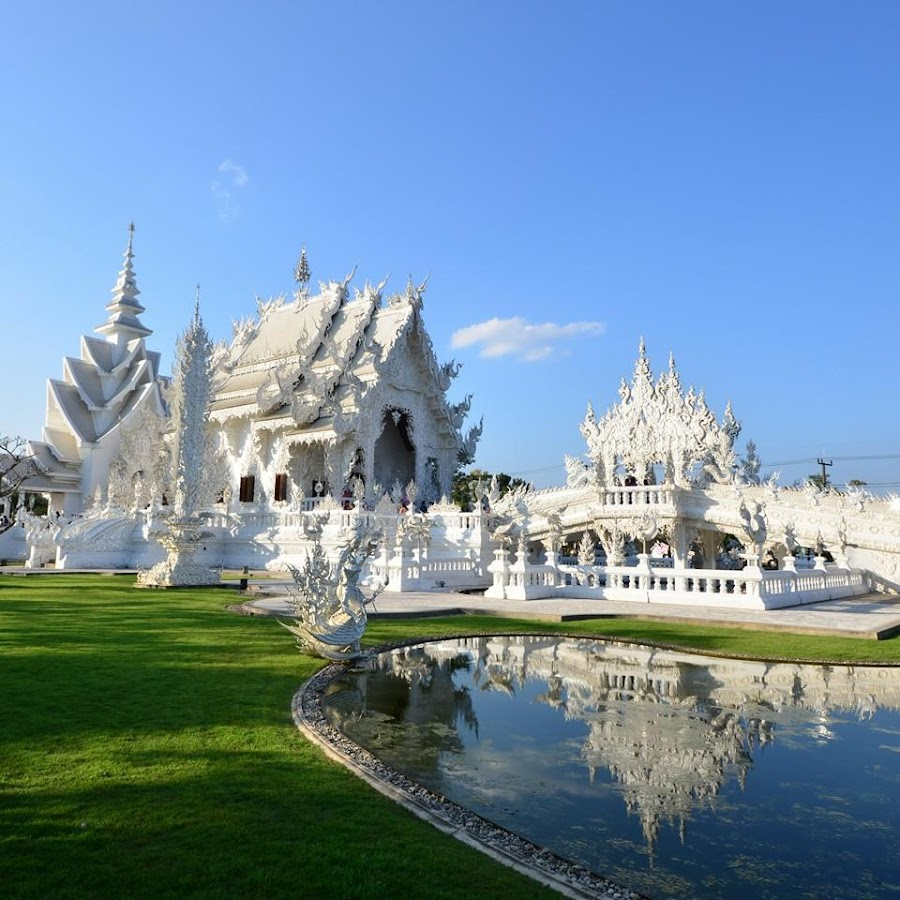 Wat Rong Khun,Thaialand by Komkrit Muangchan - Buildings & Architecture Places of Worship ( craft, oriental, thailand, thai, travel, architecture, asian, decor, religion, sky, molding, symbol, church, grass, death, art, white, carving, tourism, chiang, temple, chiangrai, sculpture, statue, native, culture, religious, reflection, mold, decorative, buddhist, landscape, wat, mirror, buddhism, rong, style, tradition, asia, khun, decoration, beautiful, traditional, handmade, exquisite, buddha, pattern, blue, reflect, design )