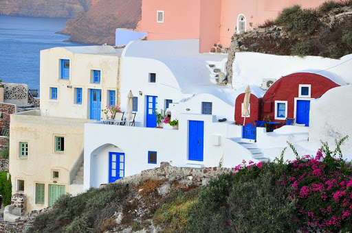oia-santorini-greece - The town of Oia sports classic Mediterranean colors on the island of Santorini, Greece.