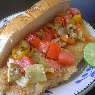 Cornmeal Crusted Fish and Olive Salad Sandwiches.