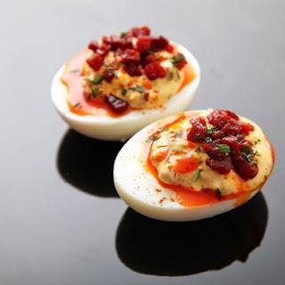 Deviled Eggs With Crispy Chorizo, Chorizo Oil, and Smoked Paprika.
