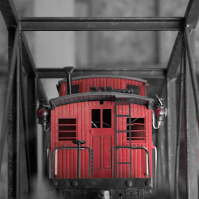 Toy Caboose on a bridge by Scott Morgan - Artistic Objects Toys ( caboose, red, toy, railroad, bridge, object )