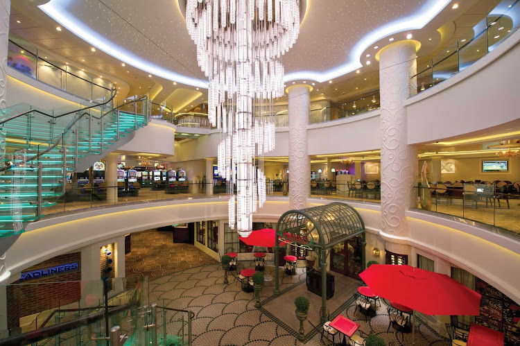 678 Ocean Place is the atrium-like centerpiece of Norwegian Breakaway, connecting guests to bars, dining options, shopping and nightlife on the ship.