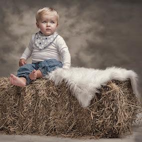 The boy with the blue eyes by Jan Kraft - Babies & Children Child Portraits ( colour, clothing, blue, feet, boy, eyes )
