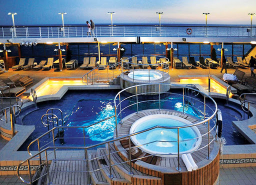 Oceania Nautica's large heated pool and whirlpool spas are the ideal location to unwind and enjoy your travels.