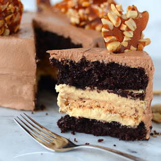 Chocolate & Peanut Cake with Caramel Peanut Butter Nougat Filling & Chocolate French Buttercream Frosting