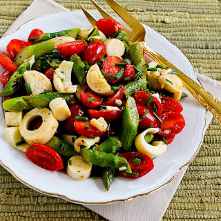 Vegan Asparagus Salad for Spring with Tomatoes, Hearts of Palm, and Chives.