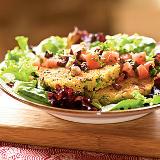 Feta and Green Onion Couscous Cakes over Tomato-Olive Salad.