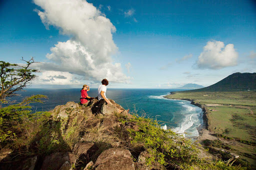 The saddle-shaped island of St. Eustatius has two volcanic crests on either end that offer engaging trails and picturesque views.