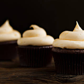 Chocolate Cupcakes with Orange Cream Cheese Frosting.