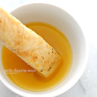 Easy Garlic Parmesan Breadsticks with Garlic Dipping Sauce