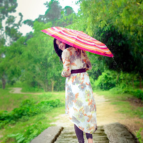 A lady with an umbrella   by Sharier Shuvho - People Street & Candids ( rainy day, umbrella, lady, road, rain )