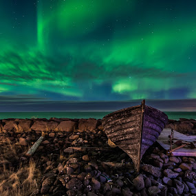 Old boat by the Bay  by Guðmundur Hjörtur - Landscapes Starscapes ( sky, by the bay, blue, green, aurora borealis, northern lights, old boat, ocean, overcast, hevane )