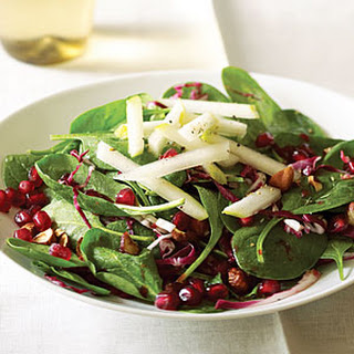 Spinach Pomegranate Salad With Pears and Hazelnuts.