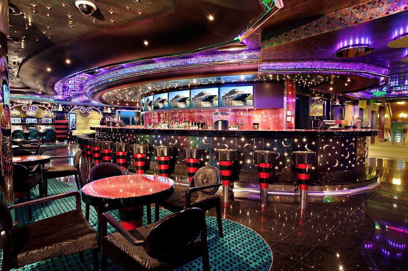 Try your luck at the Hat Trick Casino's tables and slot machines, on deck 5 of Carnival Magic.