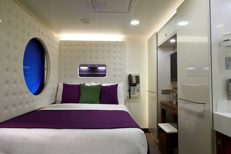 Norwegian Breakaway's specially designed studio for the single traveler features a full size bed, private bathroom, sink and shower.