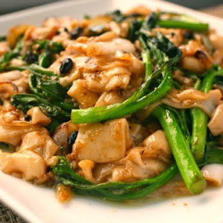Dry-Fried Chow Fun with Chinese Broccoli.