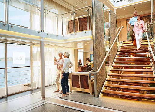 Viking-Longship-Atrium - Guests will gather in the spacious atrium before heading off on a daylong shore excursion during a typical Viking Cruises itinerary.